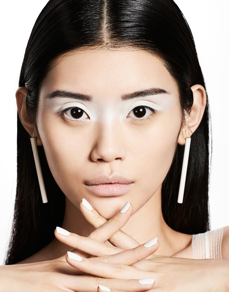 Ming Xi models white eyeshadow with matching manicure