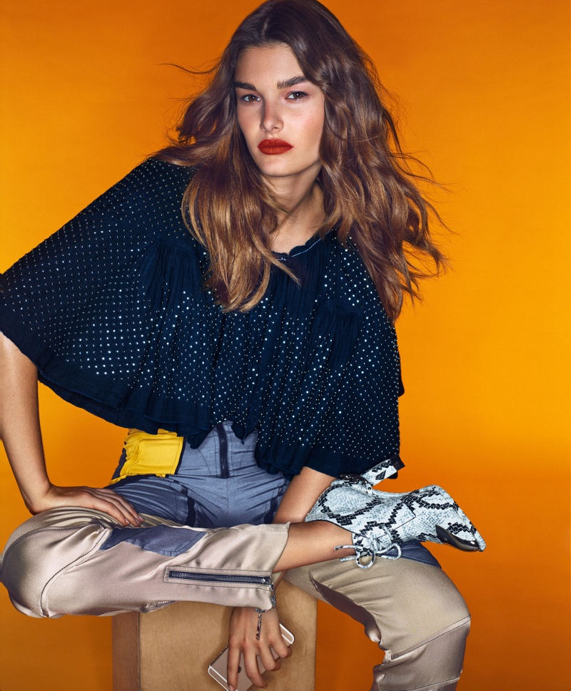 Ophelie models Louis Vuitton top, pants and boots