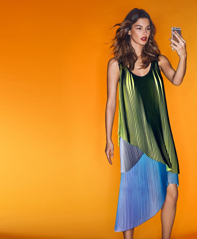 The model poses in Stella McCartney top and skirt