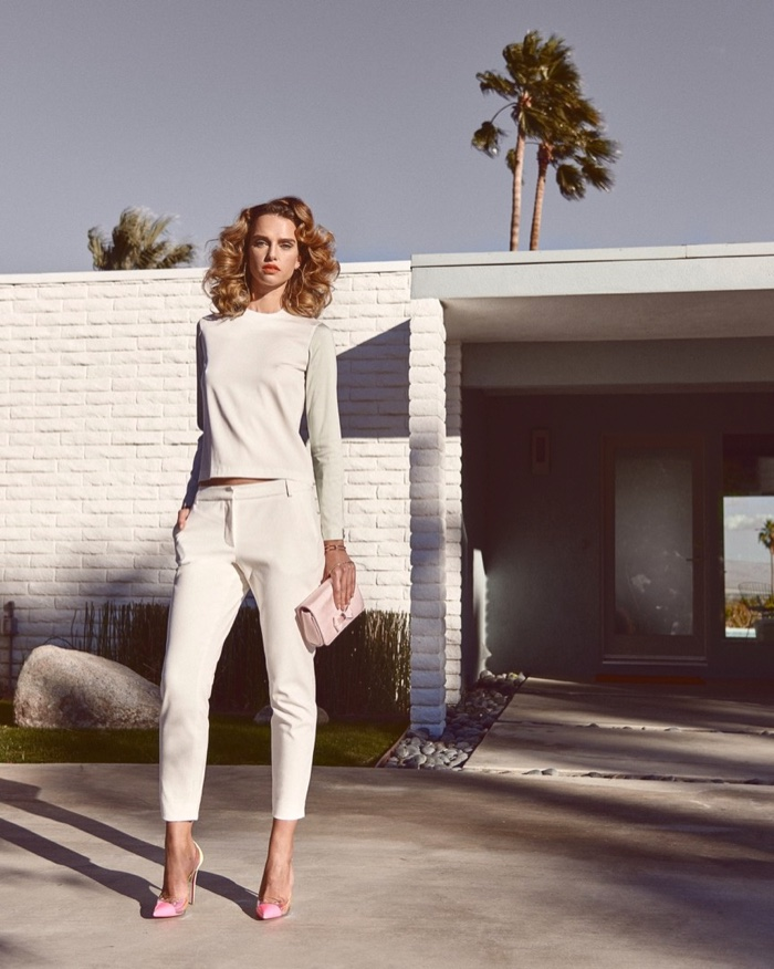 This editorial features white top and pants with pink pumps and handbag
