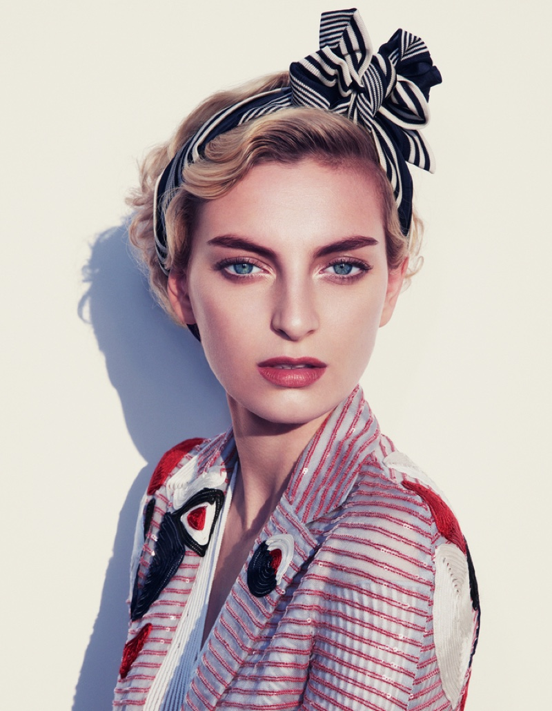 Rose Smith wears a 1930's inspired makeup look with Giorgio Armani jacket