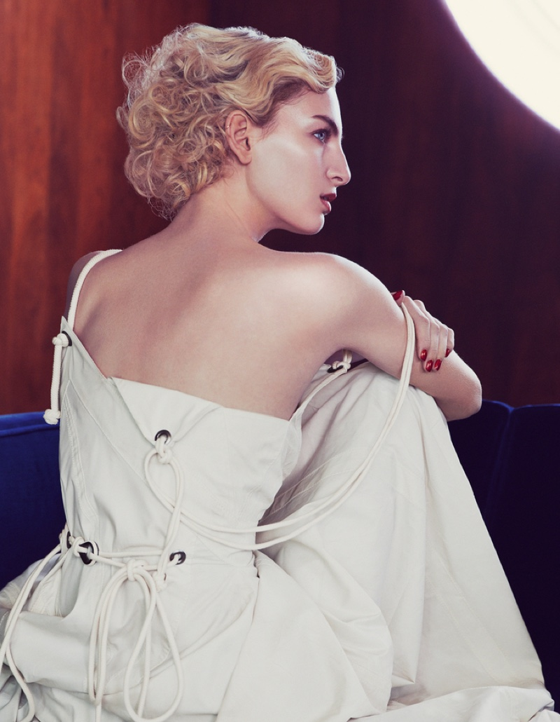 The blonde model poses in Bottega Veneta dress with rope detail