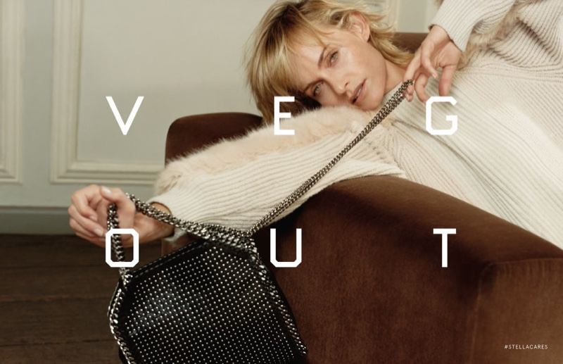 Amber Valletta wears ribbed knit sweater with embellished handbag in Stella McCartney's fall 2016 campaign