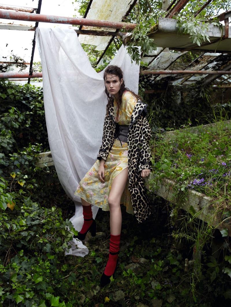 Vanessa Moody models Bottega Veneta leopard print jacket with Prada dress