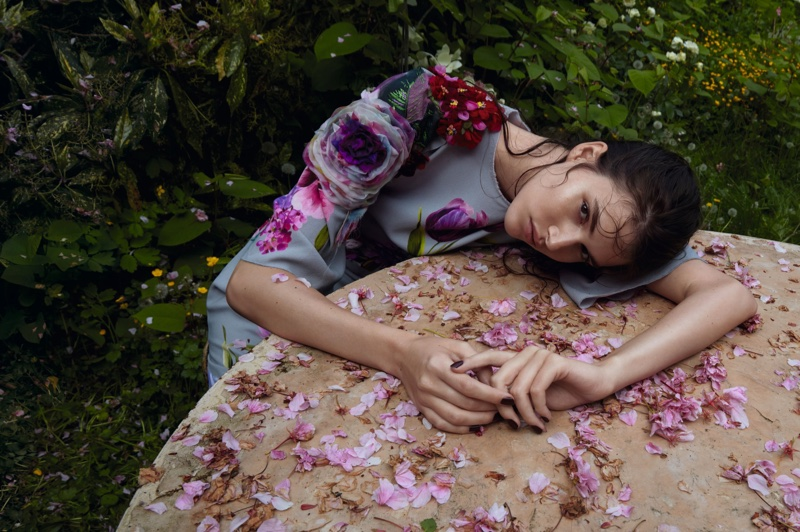 Vanessa Moody poses in floral applique dress by Dolce & Gabbana