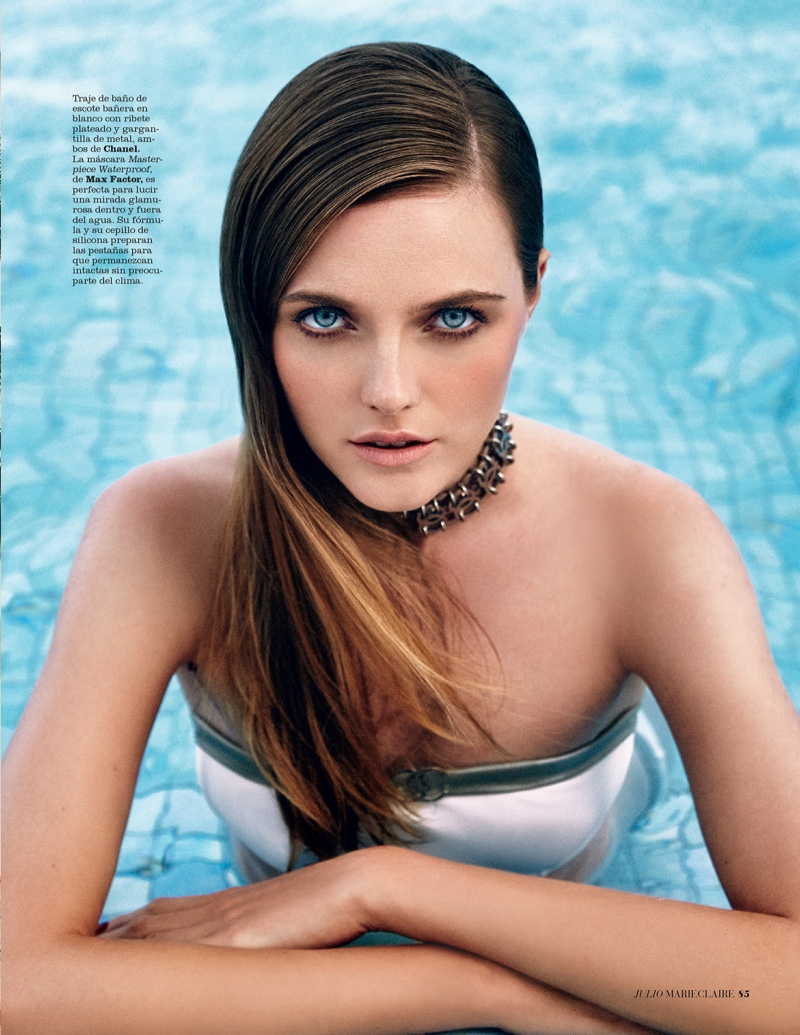 Vlada Roslyakova gets her closeup in a Chanel swimsuit and metal necklace with side-swept hairstyle