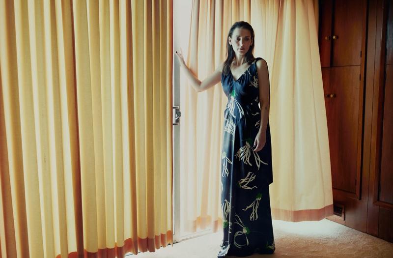 Winona Ryder poses in Miu Miu maxi dress