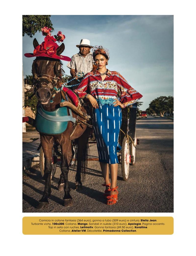 Posing next to a donkey, Zhenya Katava wears Stella Jean top and skirt