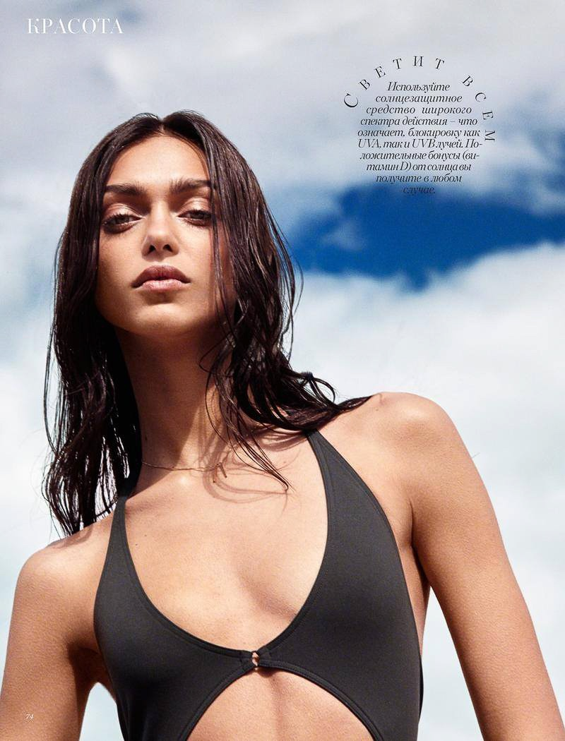 Zheyna Katava wears plunge-necked swimsuit