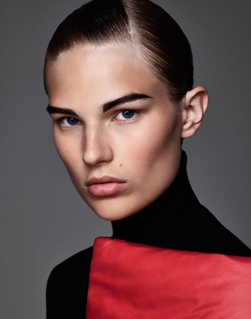 Photographed by Jason Kim, the model wears bold makeup looks