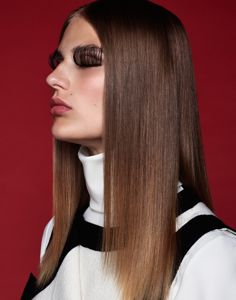 With a sleek and straight hairstyle with feathery eyelashes
