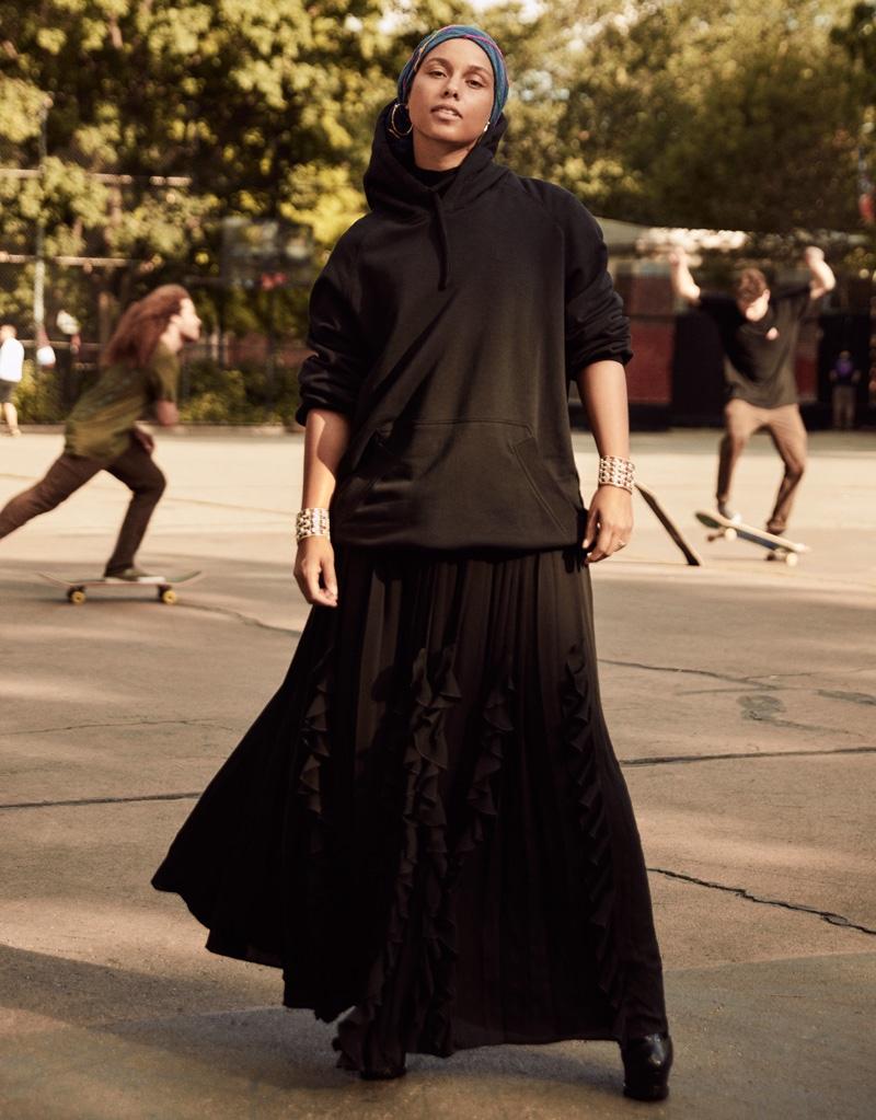 Alicia Keys wears black hoodie and embellished maxi skirt