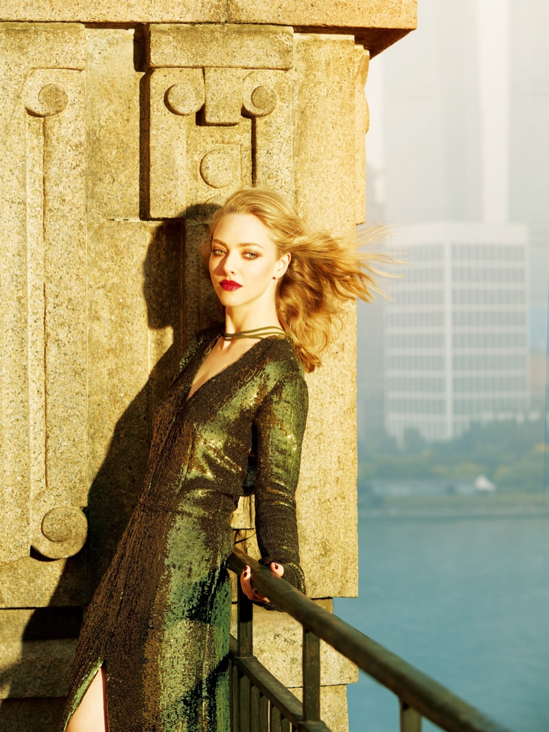 Amanda Seyfried poses in green sequin embellished dress from Nina Ricci