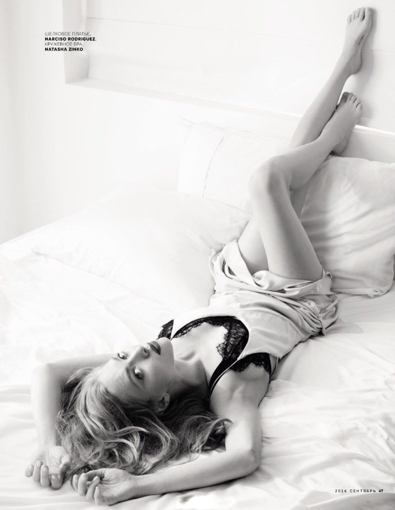 Amanda Seyfried lounges in bed wearing a Narciso Rodriguez slip dress