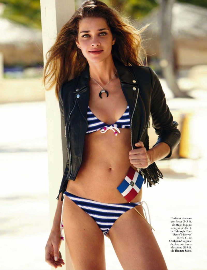 The model wears a leather jacket from Maje with striped bikini set from Triumph