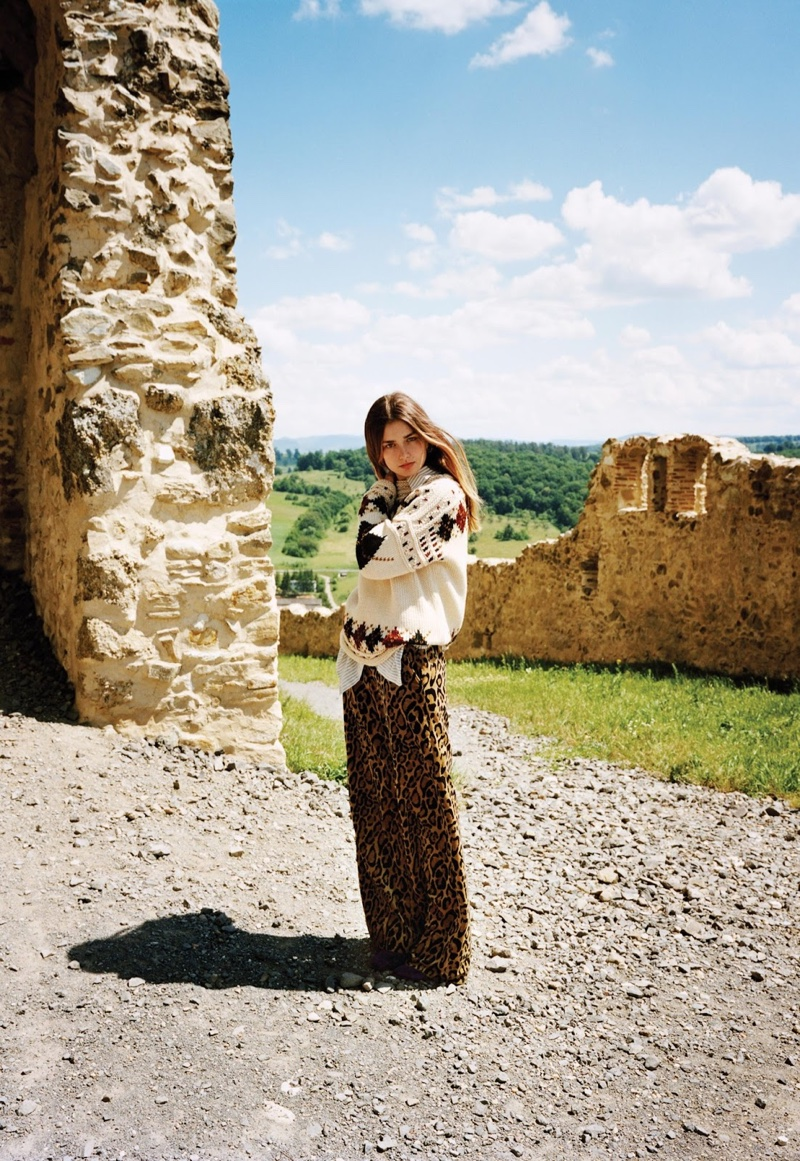 Andreea Diaconu heads outdoors in Isabel Marant sweater, Dries van Noten shirt and pants
