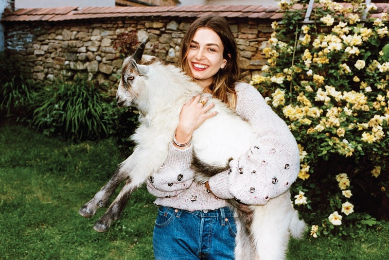 Andreea Diaconu wears embellished Chanel sweater with vintage Levi's jeans