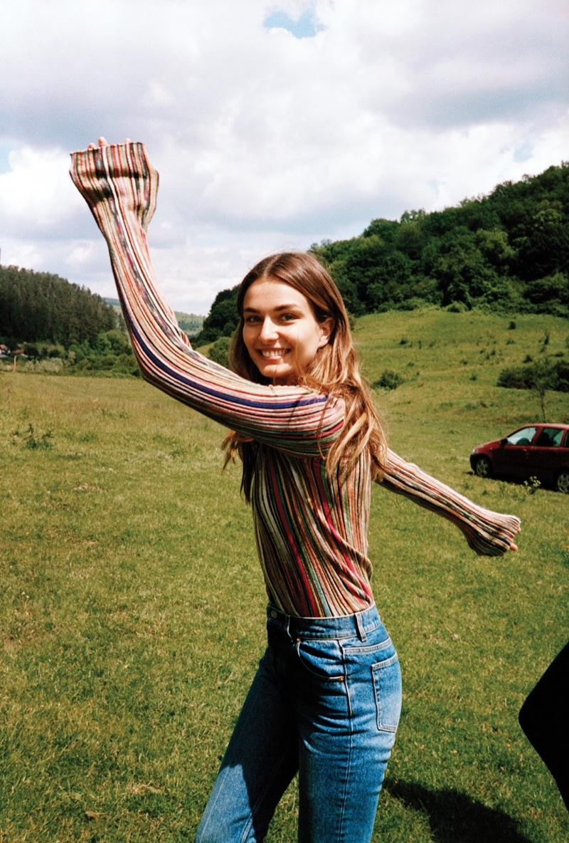Posing in the countryside, the model wears a Missoni sweater with Balenciaga jeans