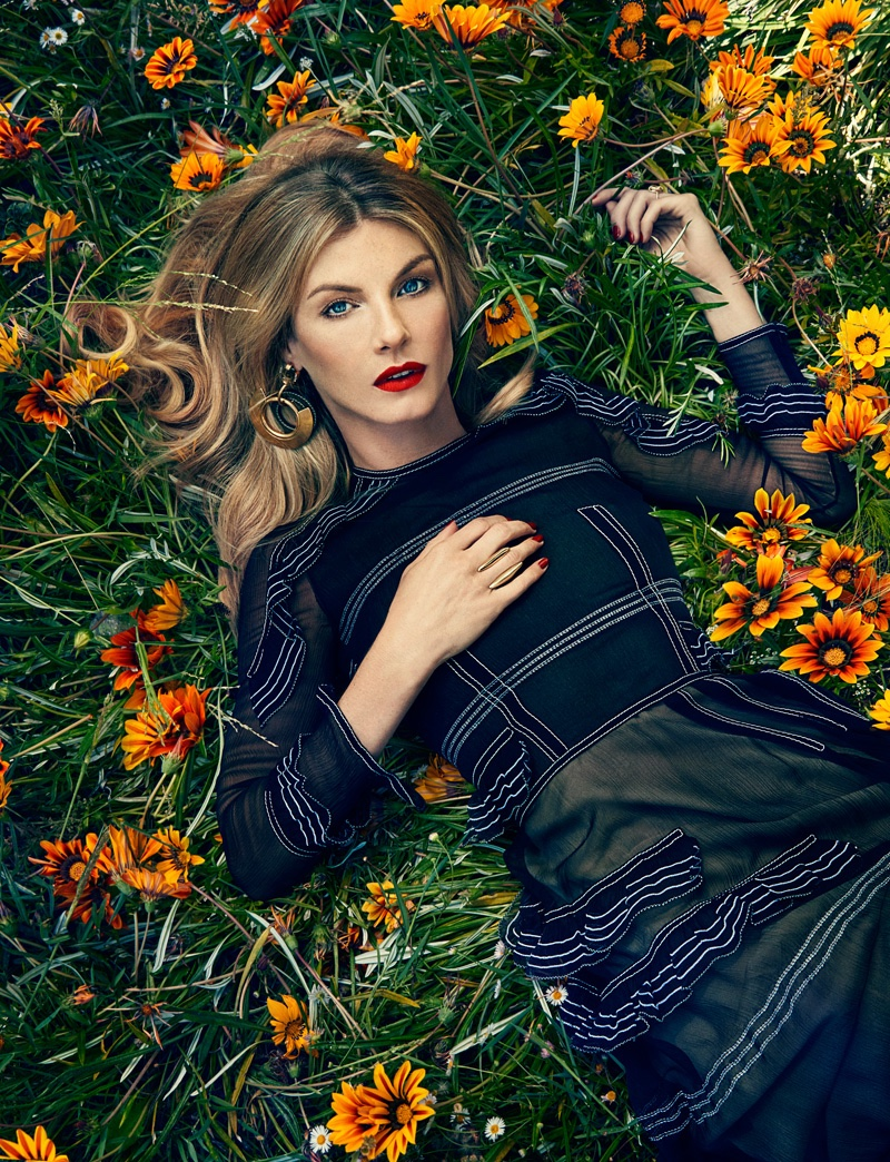 Angela Lindvall lounges in Burberry dress