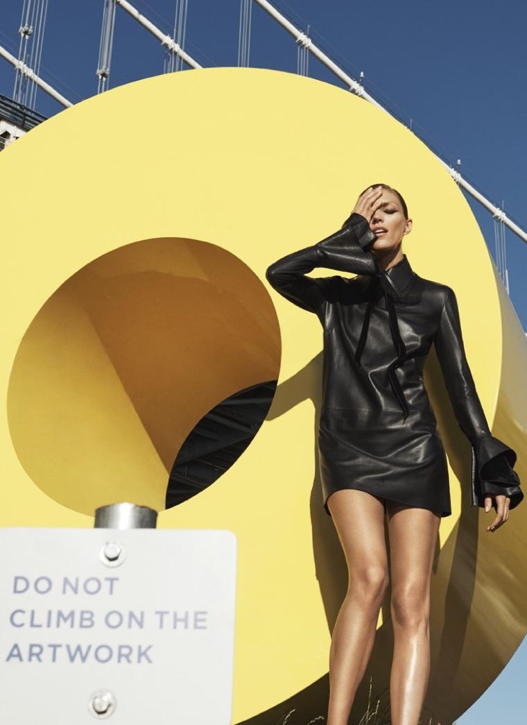 Anja Rubik poses in grommet-studded leather dress from Mugler