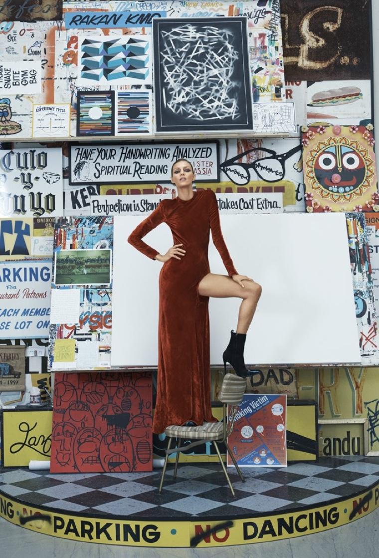 The model flaunts some leg in Haider Ackermann long-sleeve velvet gown