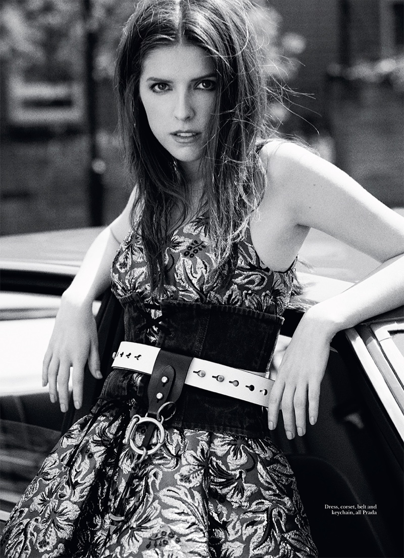 Photographed in black and white, Anna Kendrick wears Prada dress, corset and belt