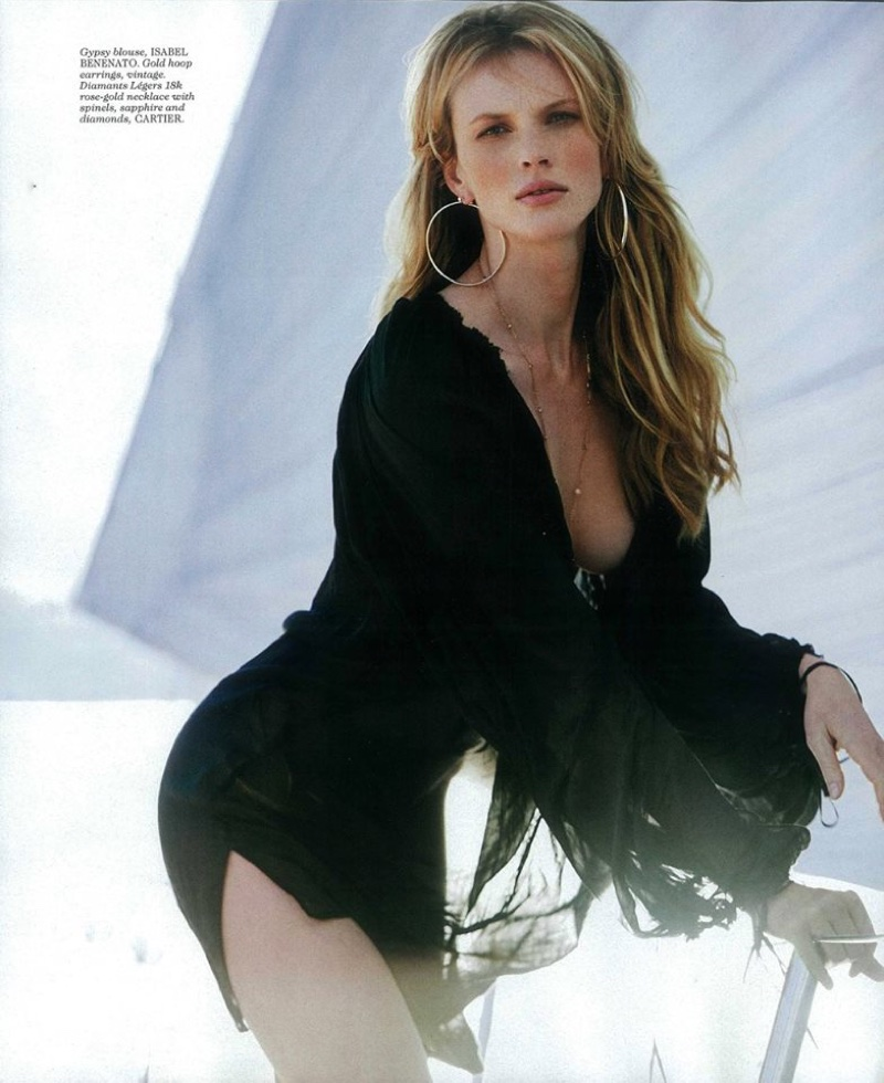 Model Anne Vyalitsyna wears blouse by Isabel Benenato with jewelry from Cartier