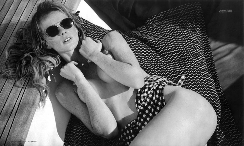 Anne Vyalitsyna poses topless in Guess swimsuit