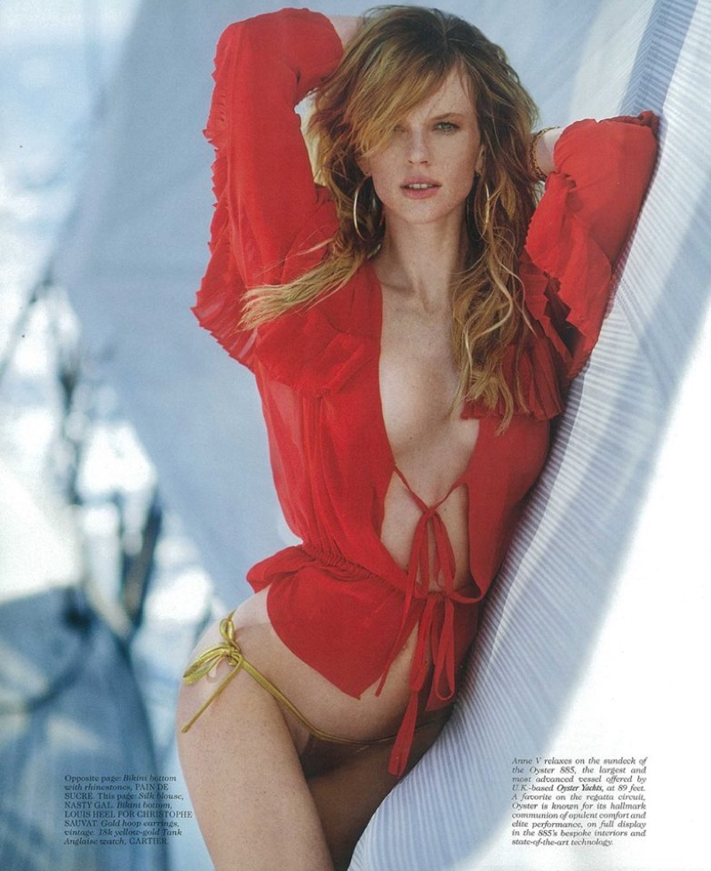 Model Anne Vyalitsyna wears red blouse and metallic bikini bottoms