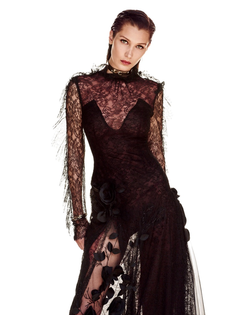 Bella Hadid poses in long-sleeve black lace gown