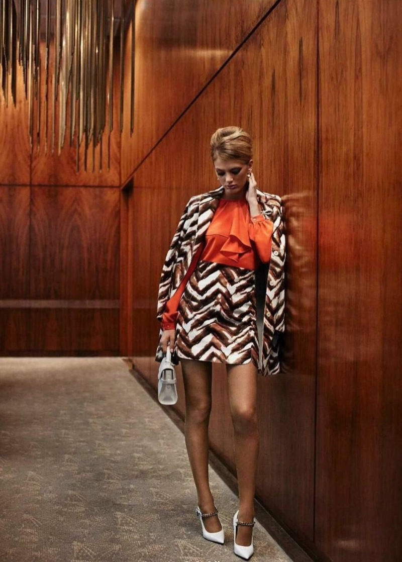 The model poses in 1960's inspired mini skirts in the fashion editorial