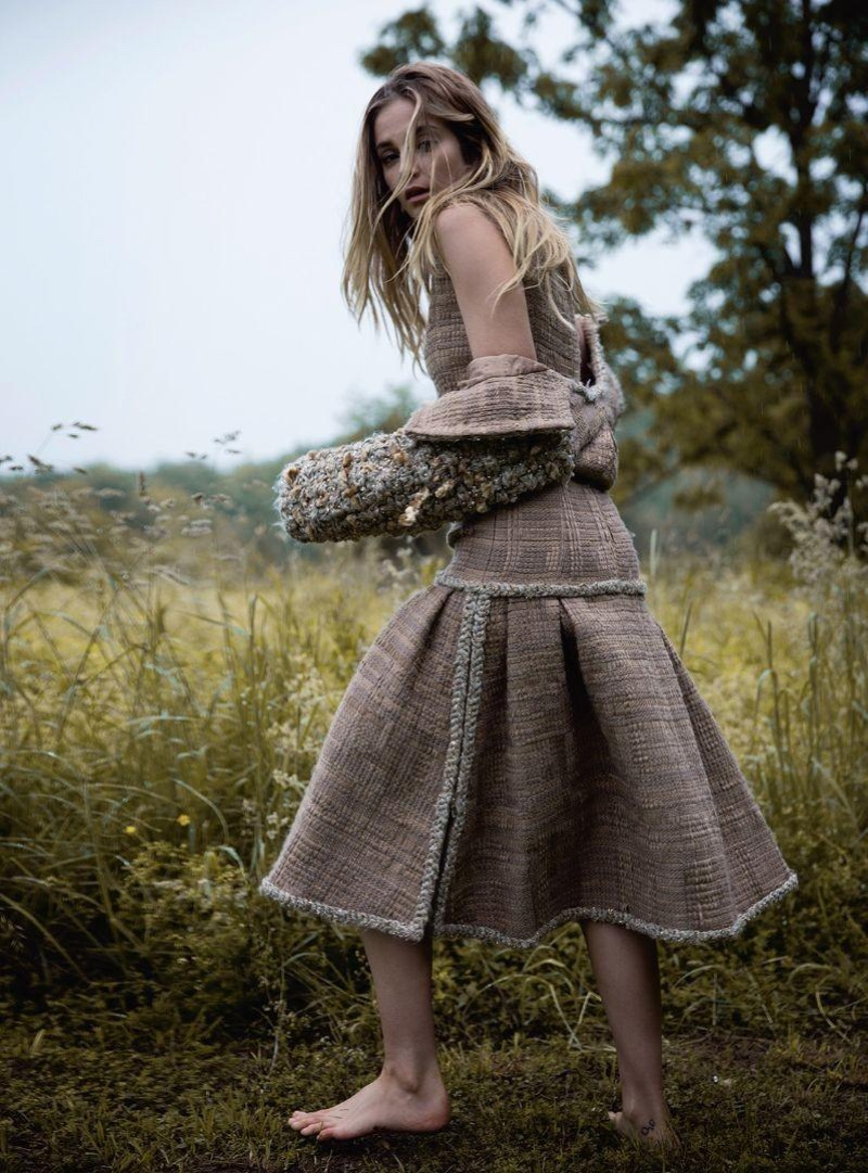 The model wears Chanel tweed jacket and dress