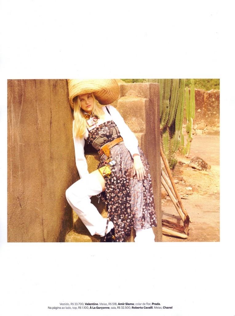 Caroline Trentini models Valentino print dress with Prada belt and accessories