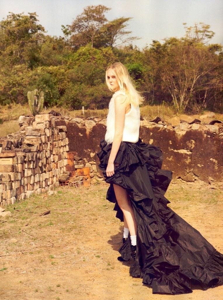 Model Caroline Trentini poses in fur vest and ruffled skirt