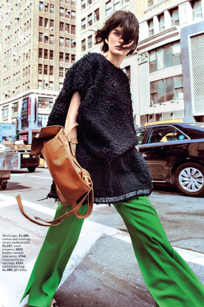 Sibui wears oversized style with Celine cape, pants, leather sandals, bag and earrings