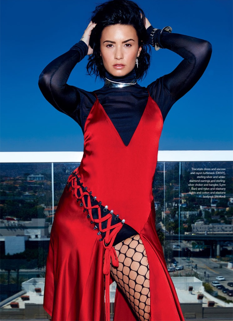 Demi Lovato flaunts some leg in slashed red dress and black turtleneck from DKNY