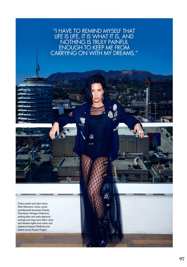 Demi Lovato poses in Red Valentino jacket and sheer dress with Fausto Puglisi boots