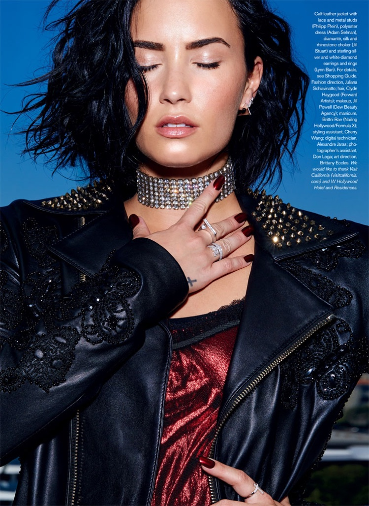 Singer Demi Lovato wears studded leather jacket from Philipp Plein with Adam Selman dress