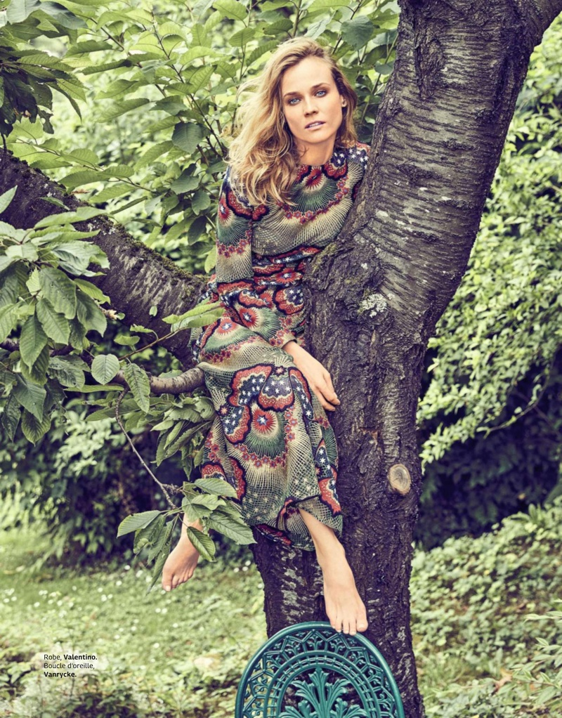 Diane Kruger sits in a tree wearing Valentino dress