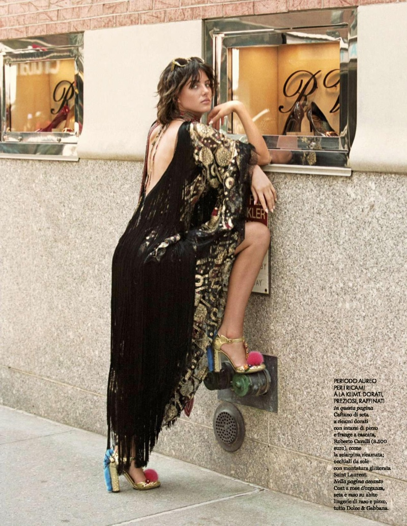 Eliza Cummings models embroidered and fringe adorned dress from Roberto Cavalli with Dolce & Gabbana heels