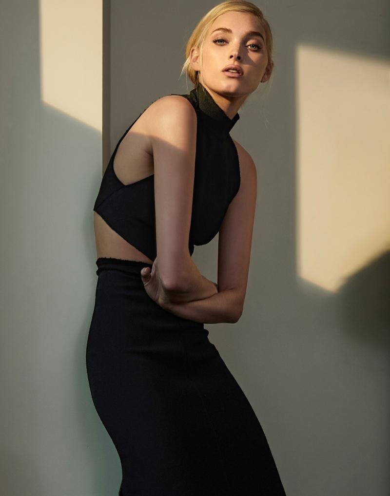 Elsa Hosk poses black crop top and skirt set