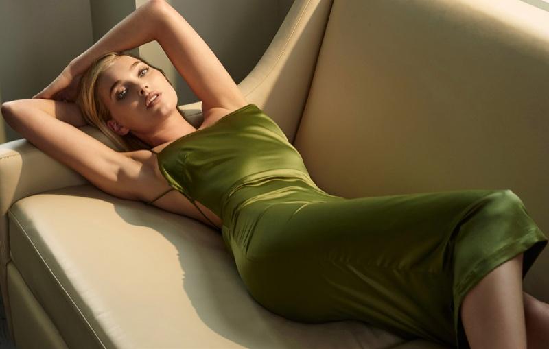 Elsa Hosk lounges in green dress