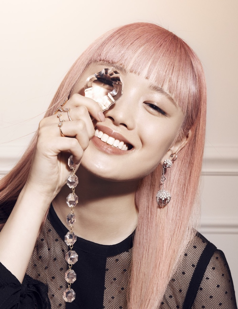 Model Fernanda Ly is all smiles with jewelry from Anita Ko and Paul Morelli