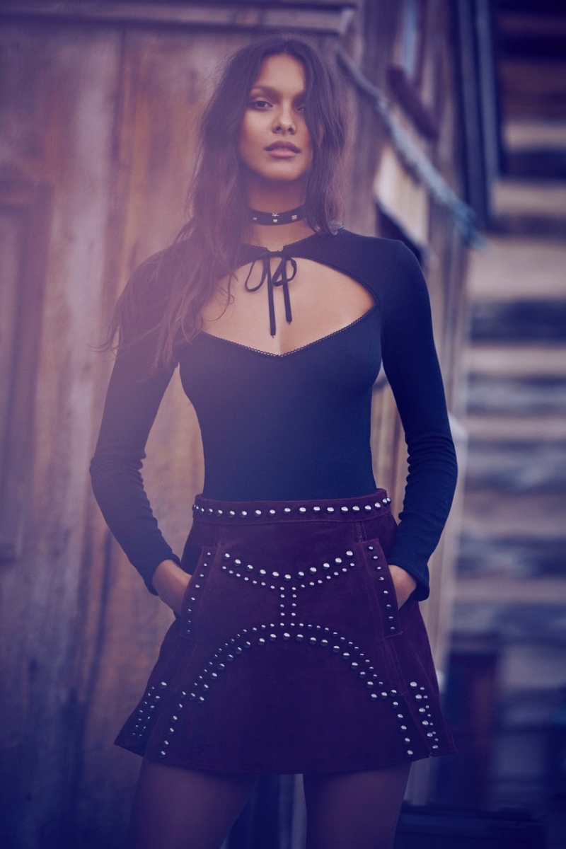 Lais Ribeiro poses in For Love & Lemons Josephina bodysuit and Jameson leather mini skirt