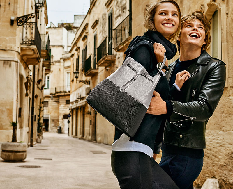 Models Ine Neefs and Jordan Barrett photographed by Mario Testino for Furla's fall-winter 2016 advertising campaign.