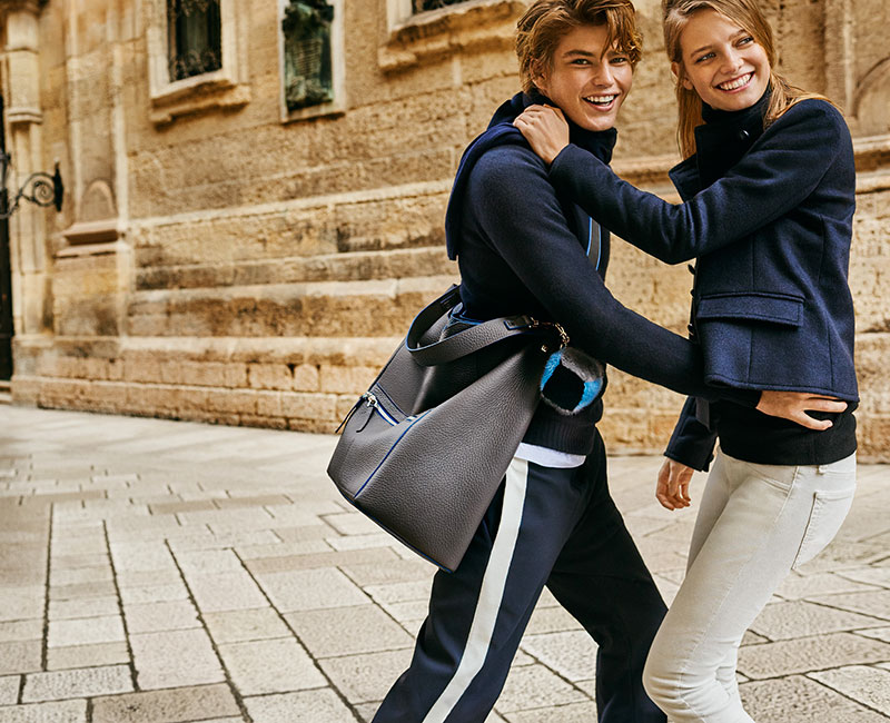 Ine Neefs and Jordan Barrett embrace a playful chemistry for Furla's fall-winter 2016 campaign.