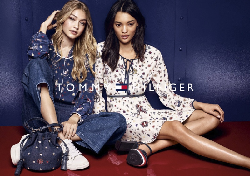 Gigi Hadid wears printed blouse, denim and bucket bag from Tommy Hilfiger's fall collection