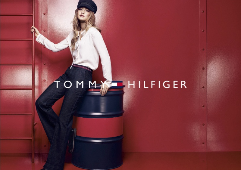Gigi Hadid wears laced up top and high-waist jeans from Tommy Hilfiger