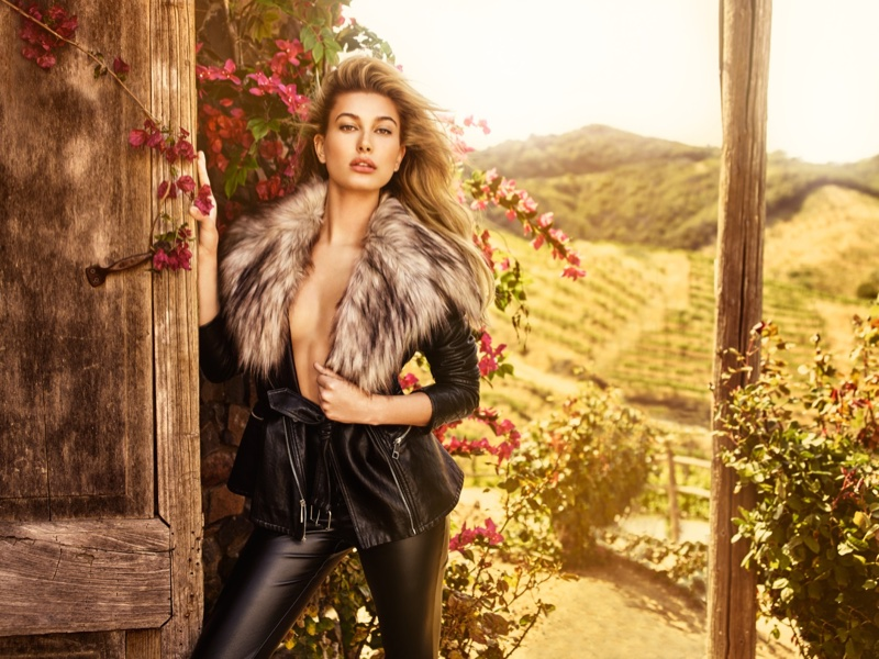 Hailey Baldwin model faux fur adorned jacket with black pants from Guess in the brand's fall 2016 campaign