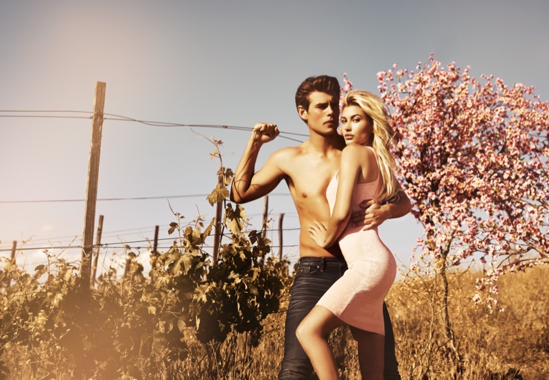 Hailey Baldwin looks pretty in pink while modeling alongside Matt Trethe for Guess